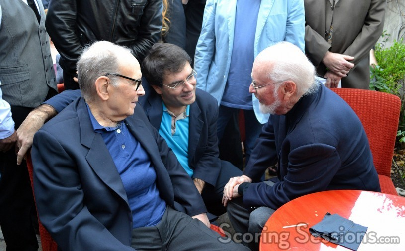 Ennio Morricone chats with John Williams; Giovanni Morricone assists with the translation (center)